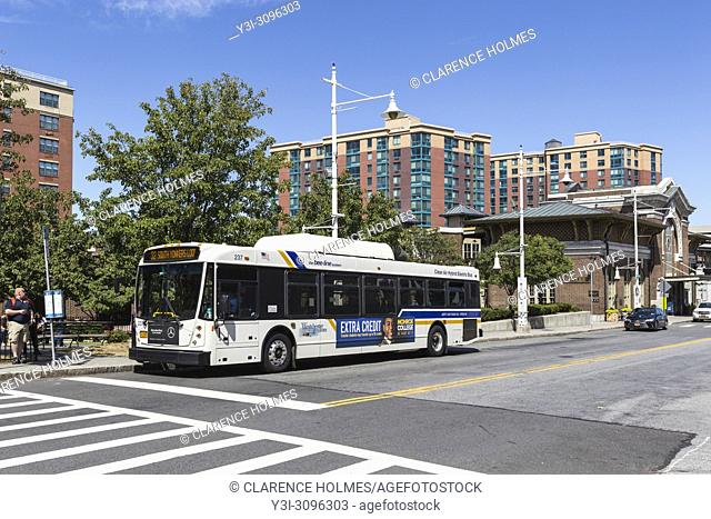 Westchester Bee-line system route 32 Yonkers loop bus waits for passengers outside of the train station in Yonkers, New York