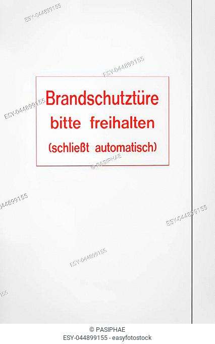 sign with red coloured letters on a white door, with german words which means fire emergency door