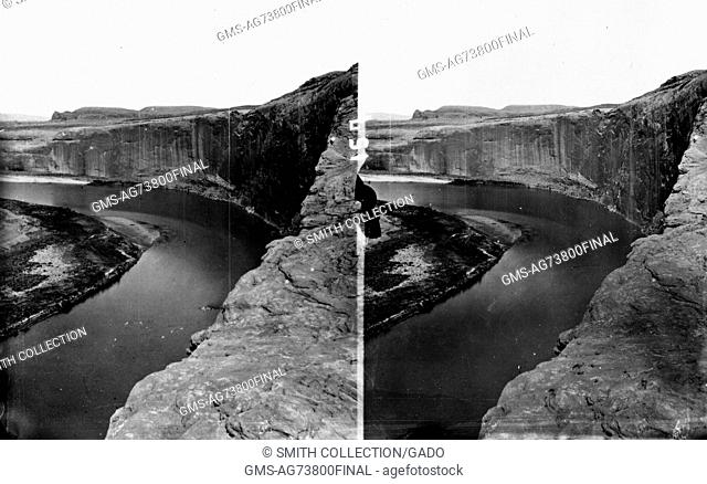 A stereograph showing the sheer cliff face of Glen Canyon on the Colorado River, as seen from the top of the canyon wall, 1872