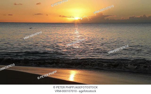 Sun setting across ocean