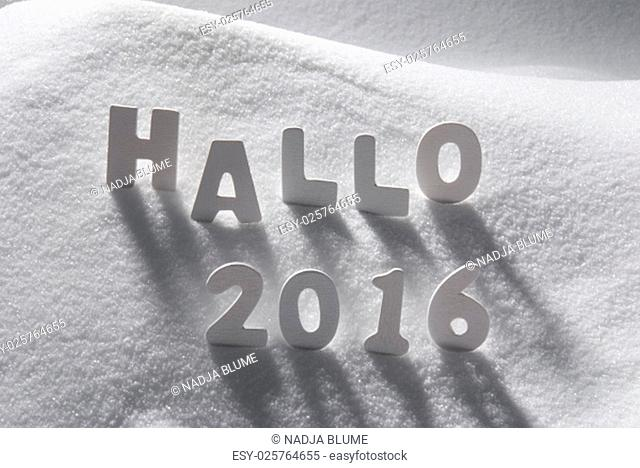 White Wooden Letters Building German Text Hallo 2016 Means Hello 2016. Snow And Snowy Scenery. Christmas Atmosphere. Christmas Background Or Christmas Card For...