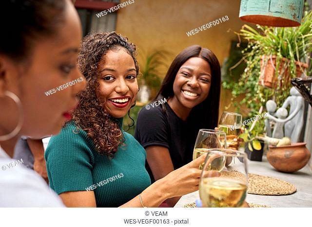 Three friends sitting in a restaurant having fun