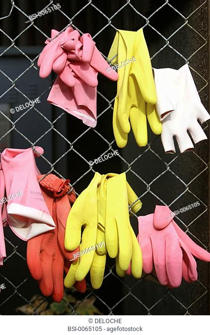 WOMAN DOING HOUSEWORK<BR>Rubber gloves