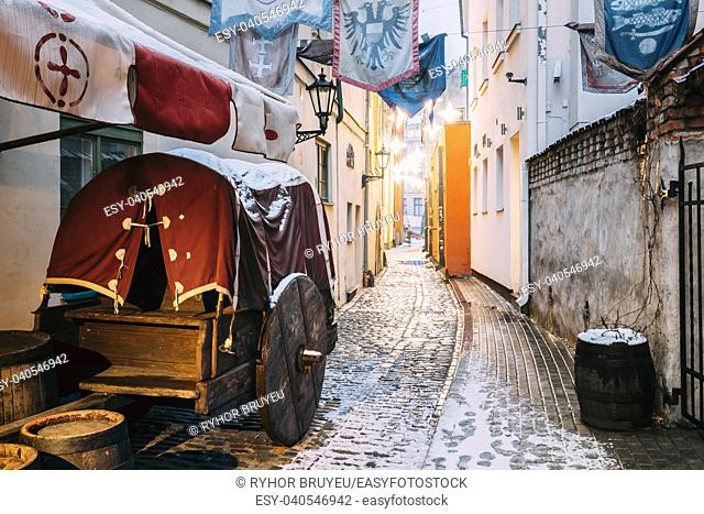 Riga, Latvia. Traditional Old Medieval Cart Is In Narrow Street Of Riga