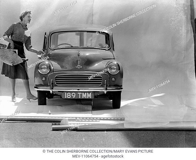 Advertisement for National Benzole petroleum -- female model opening a car door
