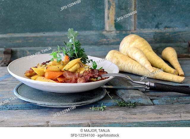 Fried parsnips and carrots with bacon