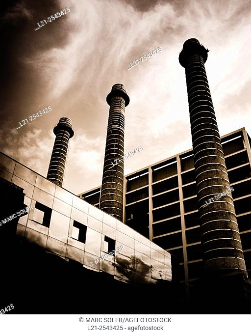 Three chimneys. Old textile industrial complex, nowadays Fecsa Building. Barcelona, Catalonia, Spain