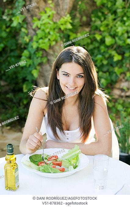 Woman having a salad outdoors