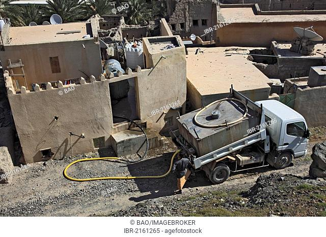 Drinking water delivery by truck in Bahla, Oman, Arabian Peninsula, Middle East, Asia