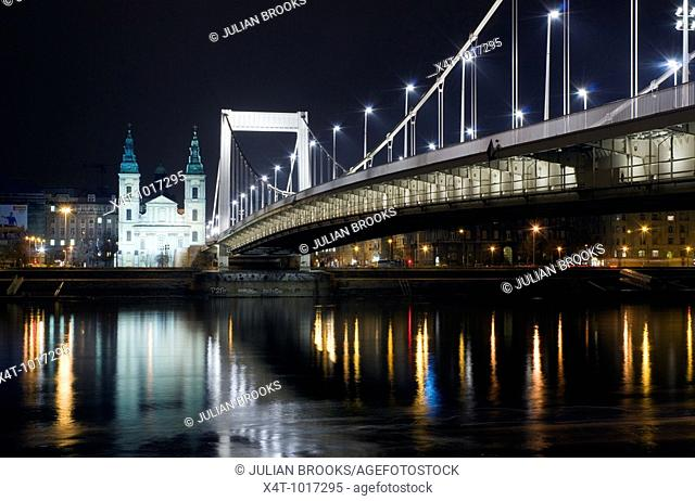 The inner city parish church and Elizabeth Bridge in Budapest at night