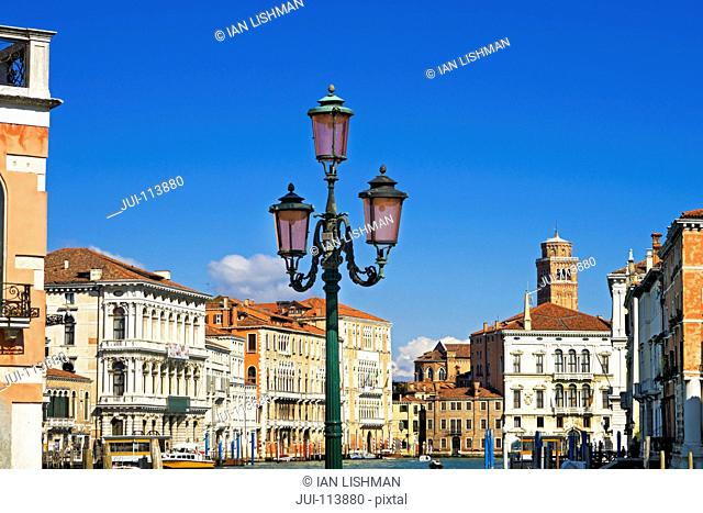 Architectural buildings on Grand Canal in Venice, Italy, under sunny blue sky