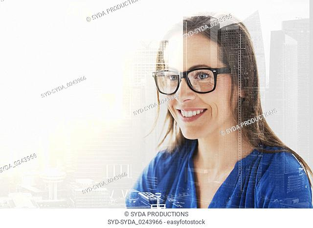 close up of smiling middle aged woman in glasses