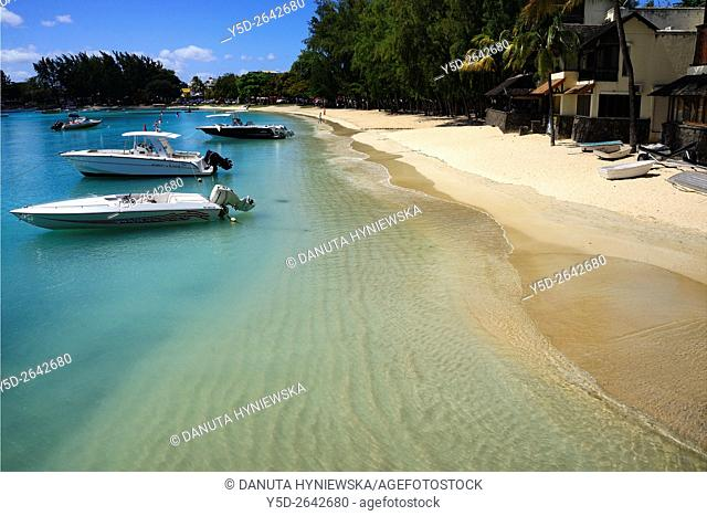 boats moored near public beach in Grand Baie on the north west coast of Mauritius, Indian Ocean, Africa