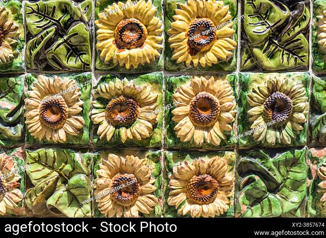 Decorative detail of sunflowers and leaves on Villa El Capricho designed by Catalan architect, Antoni Gaudi, in Comillas, Cantabria, Spain