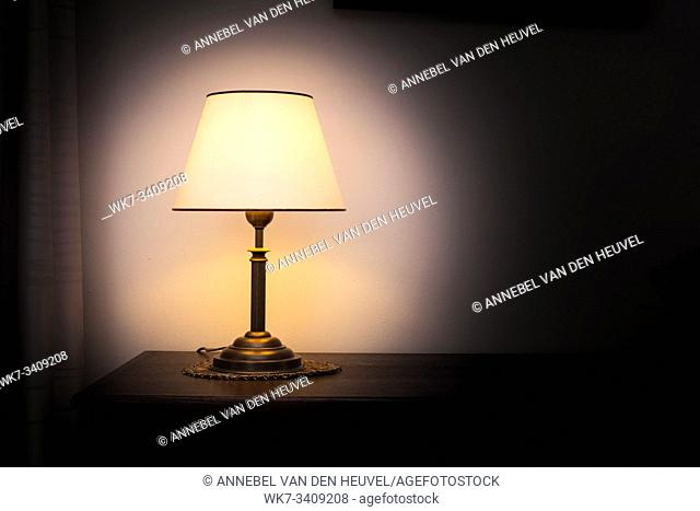 Lamp night light in a dark background. Vintage effect style picture. Minimal concept. colorful