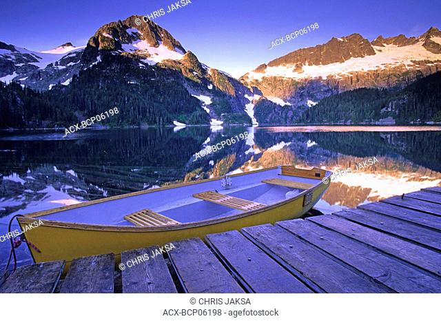 Rowboat at the Alpine Club of Canada cabin dock on Lake Lovely Water at dawn, Tantalus Provincial Park, British Columbia, Canada