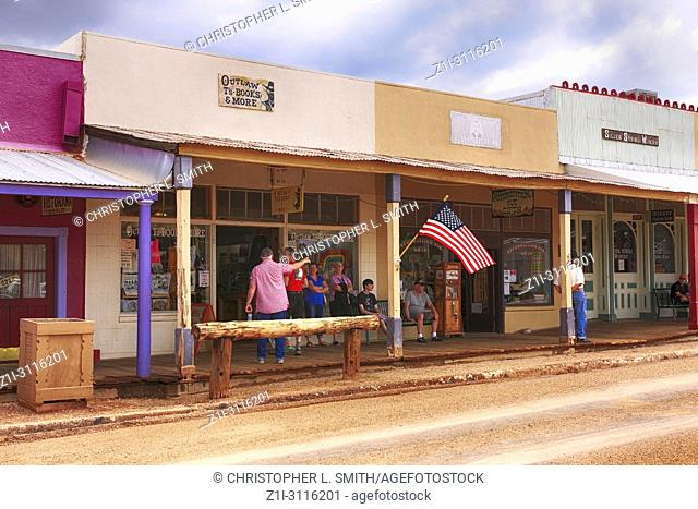 People outside stores on E Allen St selling antques and related artifacts to Tombstone, Arizona