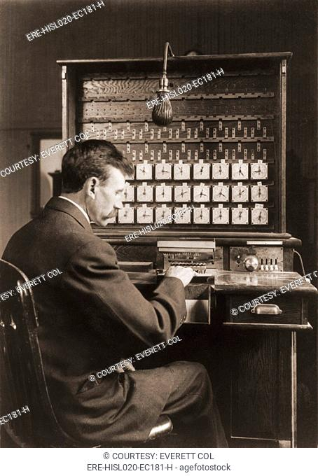 Man working with punch cards in an early tabulating machine at the U.S. Census Bureau, ca. 1908