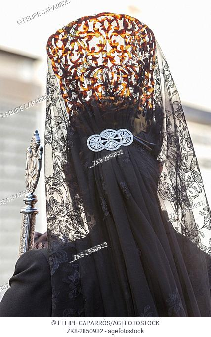 Woman dressed in mantilla during a procession of holy week, Spain