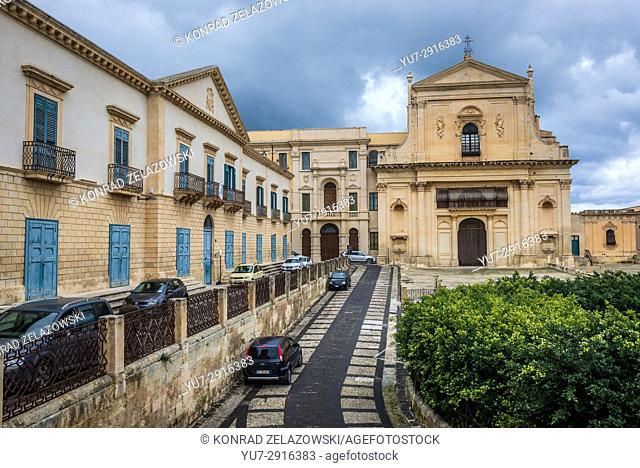 Church of Holy Saviour (Chiesa del Santissimo Salvatore) and Palazzo Vescovile, seat of Diocese of Noto (left) in Noto town, Sicily Island in Italy