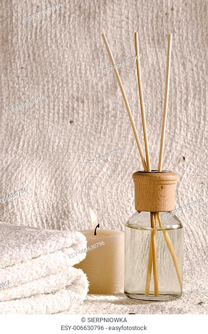aroma therapy objects. bottle of esential oil, candle, towels