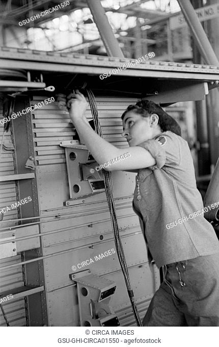 Female Worker Installing Electric Wiring in Fuselage, Vultee Aircraft Company, Nashville, Tennessee, USA, by Frank Delano for Office of War Information
