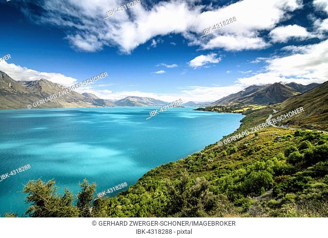 Blue sky with clouds over turquoise lake, Lake Wakatipu, right Glenorchy-Queenstown Road, New Zealand, South Island