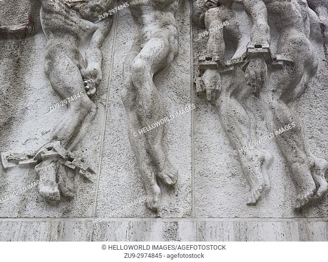 National Monument a WW2 memorial by JJP Oude (1956) on Dam Square, Amsterdam, Holland. . De Vrede (peace) showing 4 chained male figures