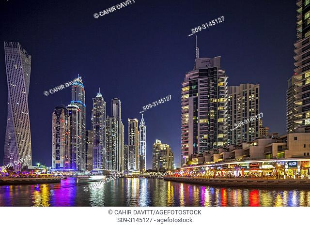 Dubai Marina at twilight with the Cayan Tower (Infinity Tower), the Dubai Marriott Harbour Hotel and Suites and various residential towers, Dubai Marina, Dubai