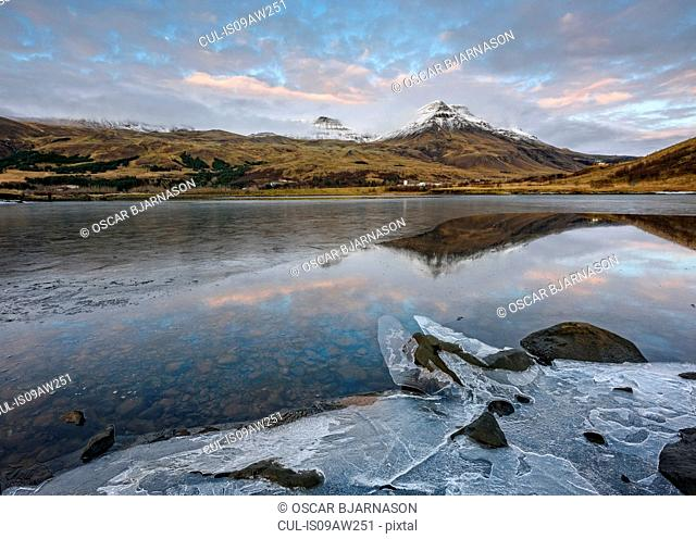 Landscape view of lake ice and mount Esja, Reykjavik, Iceland