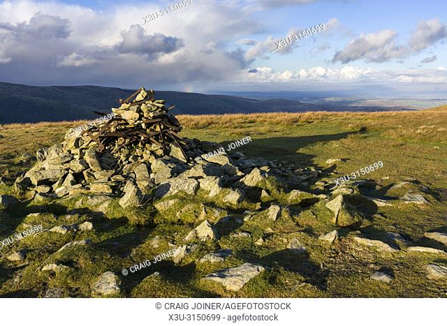 Cairn on the summit of Harter Fell with Kidsty Pike beyond in the Lake District National Park, Cumbria, England