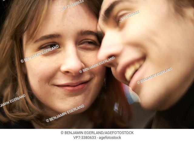 smiling man looking at woman, nightlife
