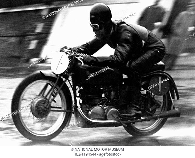 Ted Mellors winning the Lightweight TT Isle of Man race, on a 1939 Benelli, 1939. Benellie was founded in 1911, and is the oldest European motor-bike marque...