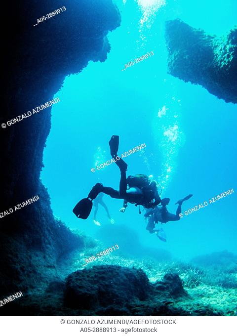 Diving in the coast of Binibeca. The place is full of caves, named catedral. Sant Lluis Municipality. Minorca. Balearic Islands. Spain