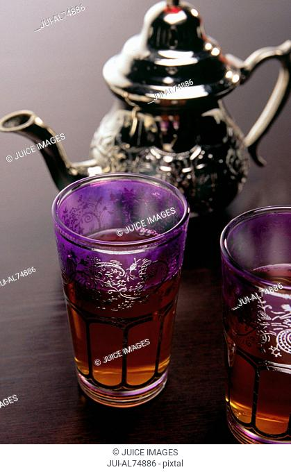 Detail view of a teapot and two glasses