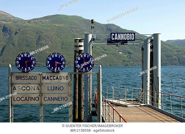 Clocks displaying departure times at the Cannobio jetty on Lake Maggiore, Piedmont, Italy, Europe