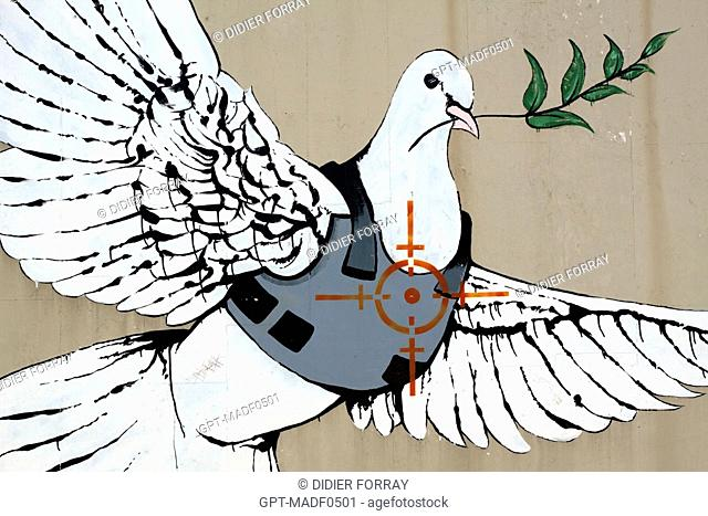 THE DOVE OF PEACE WEARING A BULLETPROOF VEST IN THE LINE OF FIRE, DRAWING BY THE BRITISH GRAFFITI ARTIST BANKSY ON A WALL IN BETHLEHEM, WEST BANK