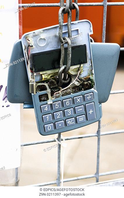 broken calculator hanging on a fence, stuttgart, baden-wuerttemberg, germany