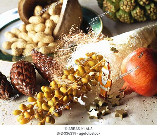 Christmas decoration with bunch of dates, sisal, pomegranate etc