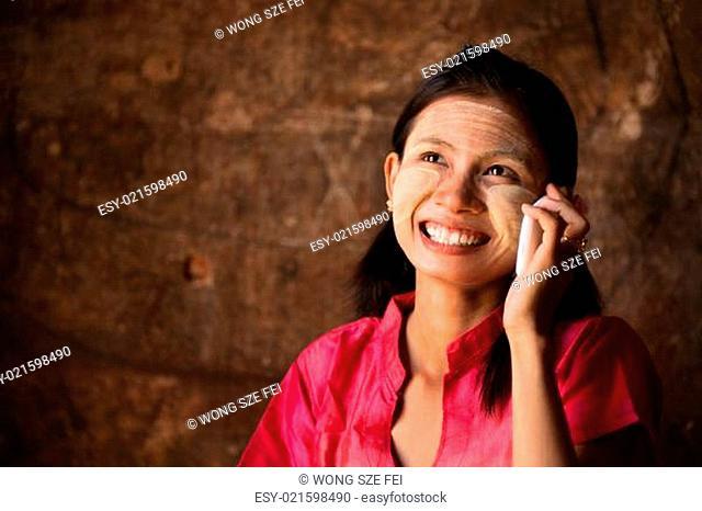 Myanmar girl using smart phone