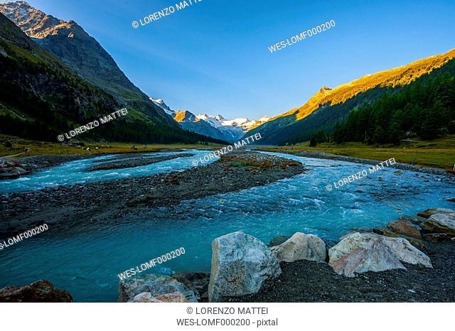 Switzerland, Roseg valley, Bernina glacier and river at sunrise in Summer