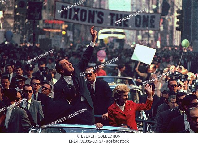 Nixon 1968 Presidential Campaign. Richard and Pat Nixon wave to the Philadelphia crowds. A huge banner reading 'Nixon's the One' is stretched across Chestnut...