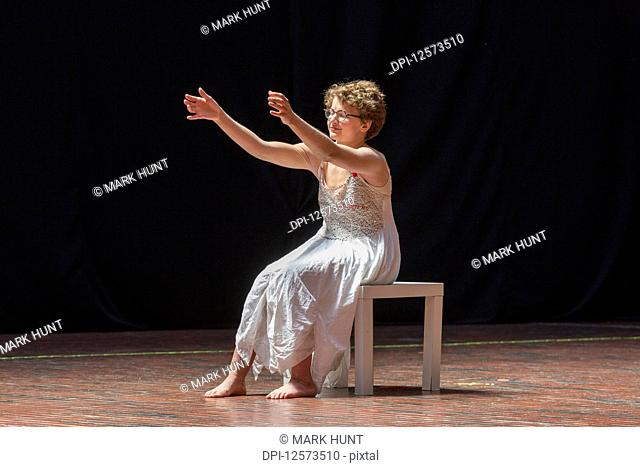 Woman with Sjogren-Larsson Syndrome performing on stage