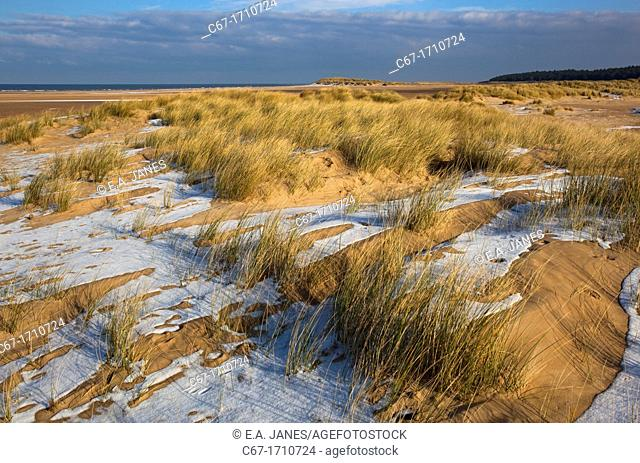 Holkham Beach and light snow over the dunes Norfolk