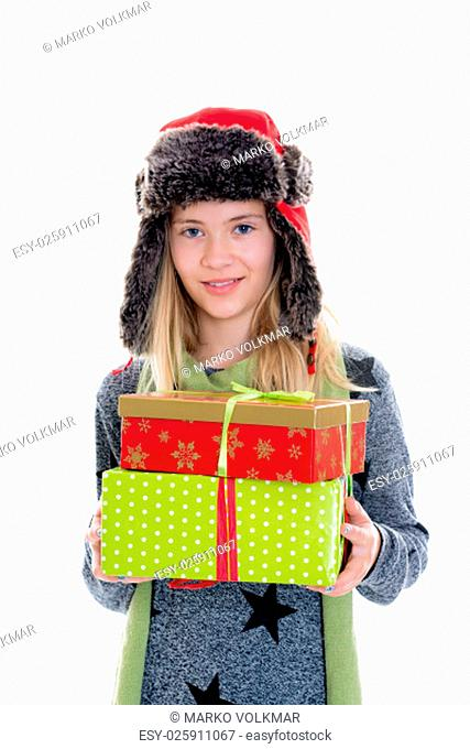 nice blond girl with gift boxes, cap and scarf in front of white background