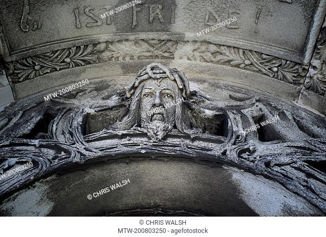 Sculpture tomb cemetery Vienna Christ detail face