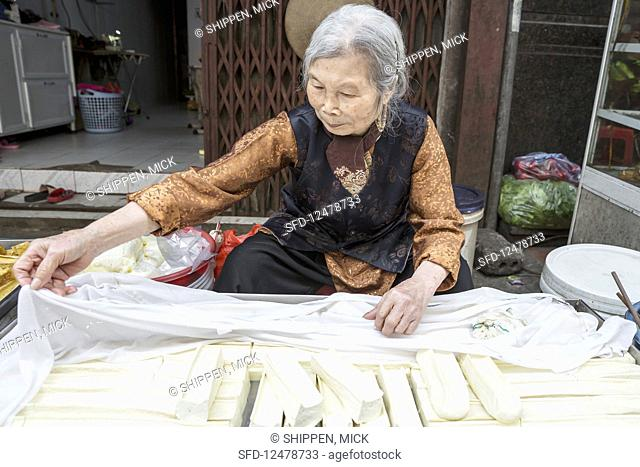 A tofu seller at a stall in Hanoi (Vietnam)