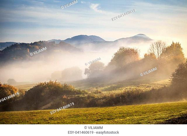 Autumn landscape in fog, misty morning in the region of Kysuce, Slovakia, Europe