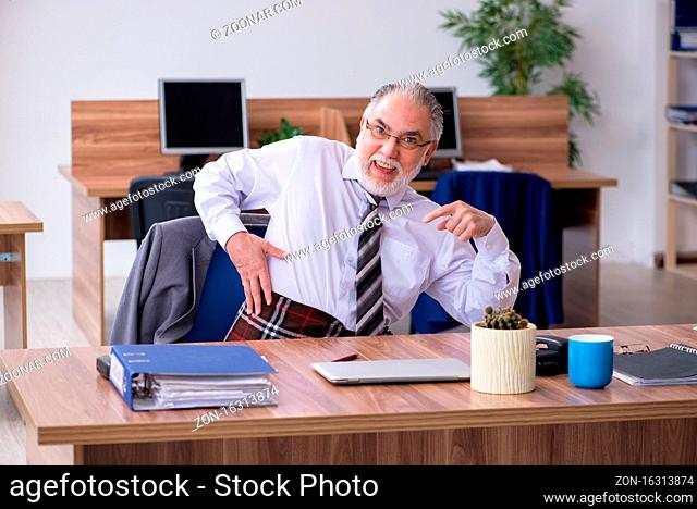 Old employee suffering from radiculitis at workplace