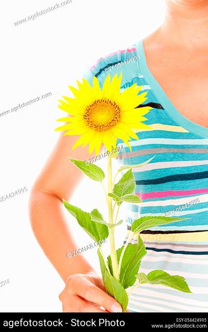 Beautiful young woman holding sunflower. Sensual feminine energy